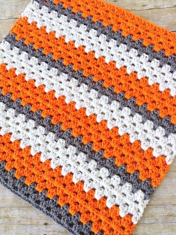 Orange, white and grey UT VOLS baby blanket This fun crochet baby blanket is the perfect gift for a new little Volunteer! Show your college football spirit with this super soft and cuddly baby blanket measuring approximately 26 x 31 - the perfect size for naptime, car seat or stroller... or to cuddle baby while attending the game! This blanket will be such a sweet prop for those newborn photos- just add a football and a tiny little quarterback! Great addition and focal point for a Tenness...