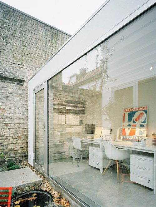 Townhouse by Elding Oscarson | Daily Icon. I like the clean white and glass juxtaposed against the brick with white paint wearing off.- build between wings of house