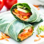 Rainbow Raw Veggie Hummus Wrap | This rainbow raw veggie hummus wrap is loaded with nutritionally-packed carrots, tomatoes, avocado, and greens for a healthy lunch, low-carb snack, or vegan dinner recipe to tackle your healthy eating goals!