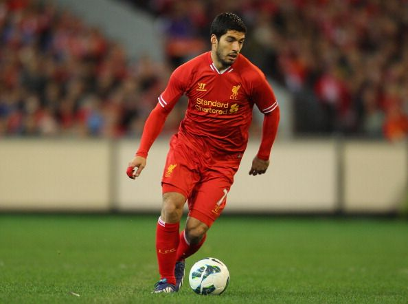 Luis Suarez of Liverpool runs with the ball during the match between the Melbourne Victory and Liverpool at the Melbourne Cricket Ground on July 24, 2013 in Melbourne, Australia