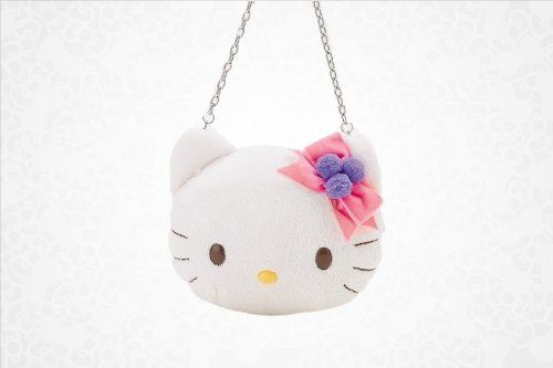 "Hello Kitty Boa Coin Purse: Ornament by Hello Kitty. $16.99. See Product Description below. Measures: 4.25"" x 1.5"" x 5"". The perfect little bag for special evenings out or everyday glam this lovely Hello Kitty boa coin purse will let you dazzle in super cute style. Purse is an adorably soft Hello Kitty face sweetly adorned with a pretty hair ribbon. Stylish chain link carry handle."