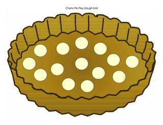 Pie playdough mat. Roll up balls of dough and add them as cherries to the pie.