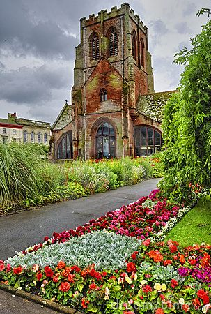 Old St. Nicholas Church and beautifully landscaped gardens in Whitehaven, Cumbria, England.