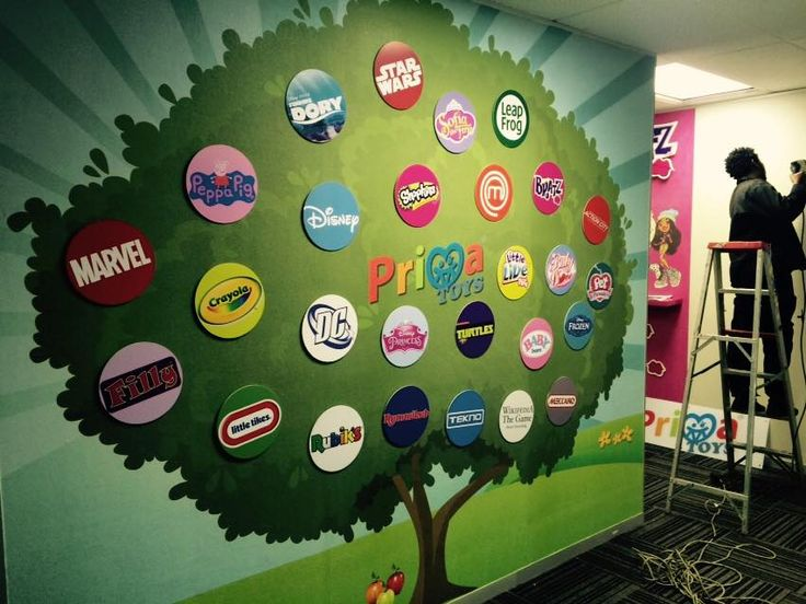 Wallpaper Tree with velcro'd logos that are interchangeable