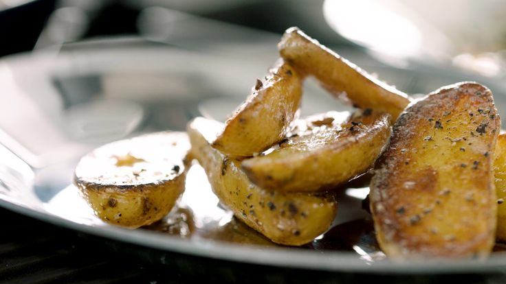 Fingerling Potatoes STEP 2: Cut the potatoes in half. Heat oil in a large non stick pan. Add in potatoes cut side down and cook until browned. Flip the potatoes. Season with salt and pepper and finish with a knob of butter.