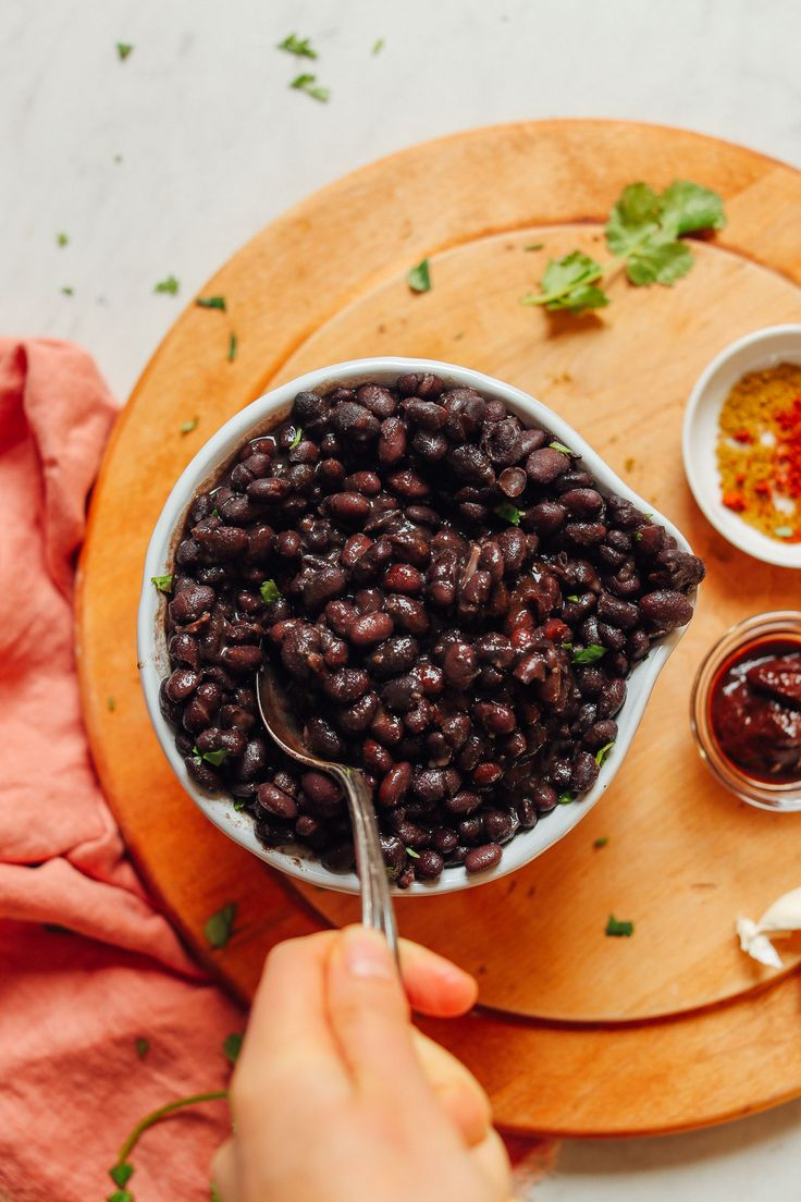 Big serving bowl filled with perfectly tender beans from our easy 1-Pot Black Beans recipe