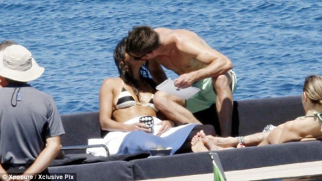 Sneaky smooch: Zac Efron and Michelle Rodriguez have finally confirmed they are dating aft...