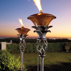 Pineapple Torches. A lot fancier than my Tiki torches. These would so great around my pool area.