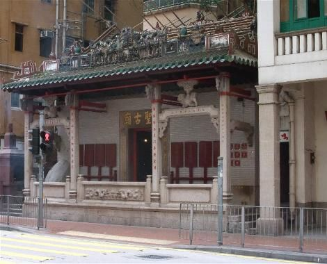 "HUNG SHING TEMPLE (Queens Road East) – Built mid-19th century against a boulder protruding inside which is used as a small altar table. ""Shiwan"" ceramic pottery decorations adorn the roof. Adjacent is Kwun Yin Temple built about 1910."