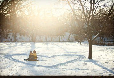 picture idea for a winter wedding save the date - couple in the snow