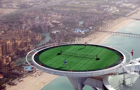 This mile-high tennis match looks like some cheesy special effect from a Nike commercial. But no, it's just Dubai, whose entire economy seems to be based on building enormous things that exist only for the purpose of not making any goddamn sense. In that spirit they hosted this tennis match between Andre Agassi and Roger Federer on a helipad located on top of the Burj Al Arab skyscraper.