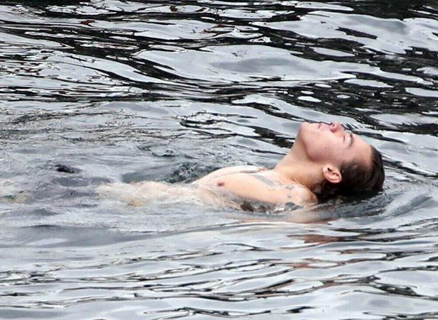 wwatourmoments:  Harry Styles swimming in Lake Como, 6/29/2014