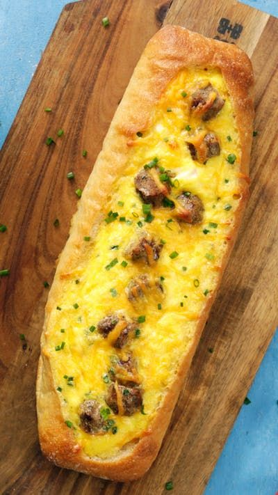 Take a ride on a breakfast boat loaded to capacity with savory sausage and a scrambled egg and cheese mix.