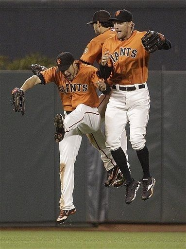 San Francisco Giants outfielders Hunter Pence, right, Gregor Blanco, and Angel Pagan celebrate