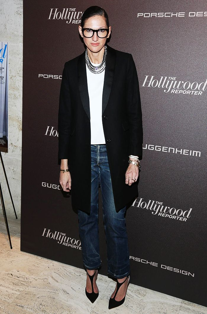 Jenna Lyons' keeps it simple with a black long structured blazer, white top, statement necklace, and dark denim