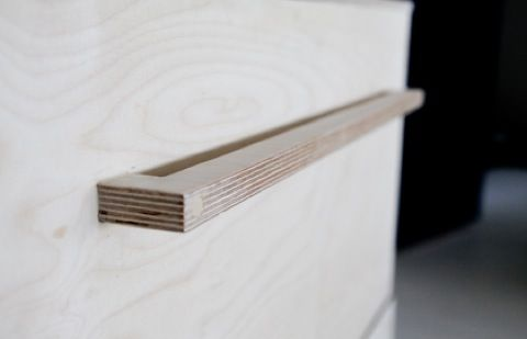 Drawer handles made from scrap birch ply wood and decking screws.
