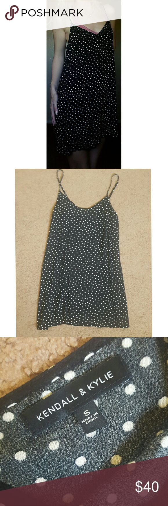 Polka Dot Slip Dress K&K So I really don't even want to sell this but I really should have gotten a medium. It's sold out online and everywhere else so I'm selling for full retail or the off chance that SOMEONE out there is desperately wanting to trade a M/L for this small. Lol a girl can dream!? I can't get over how cute this thing is but if you want it for retail price it's yours! 100% crepe Rayon Kendall & Kylie for Pacsun Kendall & Kylie Dresses Mini