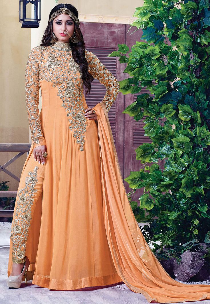 Faux Georgette Abaya Style Kameez in Pastel Orange This Prepossessing Semi-stitched attire with Poly Shantoon Lining is Adorned with Zari, Stone, Applique and Patch Border Work Available with a Poly Shantoon Straight Pant and Faux Chiffon Dupatta in Pastel Orange Available with a Poly Shantoon Straight Pant and Faux Chiffon Dupatta in Pastel Orange Do note: Accessories shown in the image are for presentation purposes only and length may vary upto 2 inches.(Slight variation in actual color…