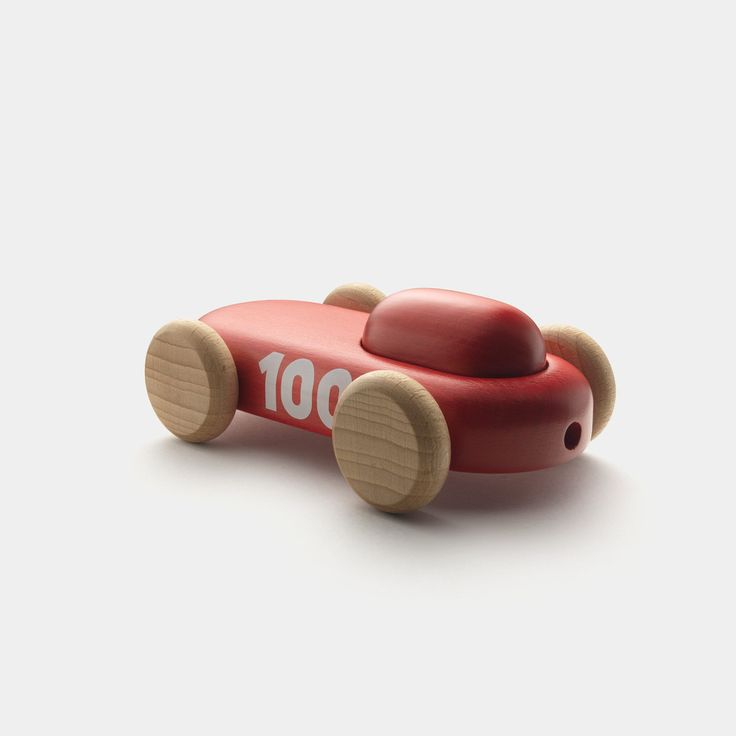 Permafrost's red wooden 100 racer car toy seen from the back