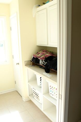 laundry organization, shelves for baskets, do countertop for folding and a drying rack above instead of cabinets