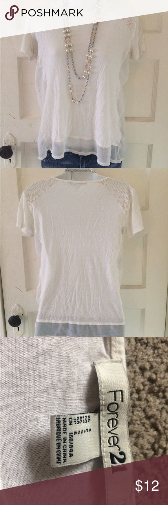 NWOT SIZE SMALL FOREVER 21 BEIGE SHORT SLEEVE TOP Forever 21 size small beige short sleeve blouse. Flowy and breathable fabric. Thin see through top layer studded shoulders Forever 21 Tops Blouses