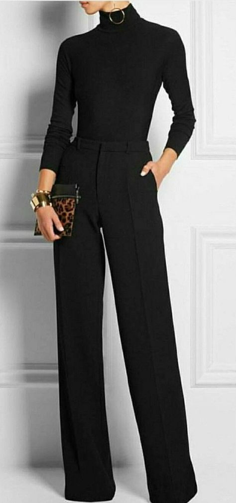 Black turtleneck top makes another appearance. Flared-leg extra long trousers (i.e. power pants) worn over stilettos, probably.