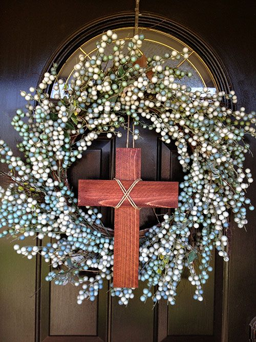 Easy DIY Easter Wreath. Take a plain wreath and add a cross for Easter. Simple and subtle!