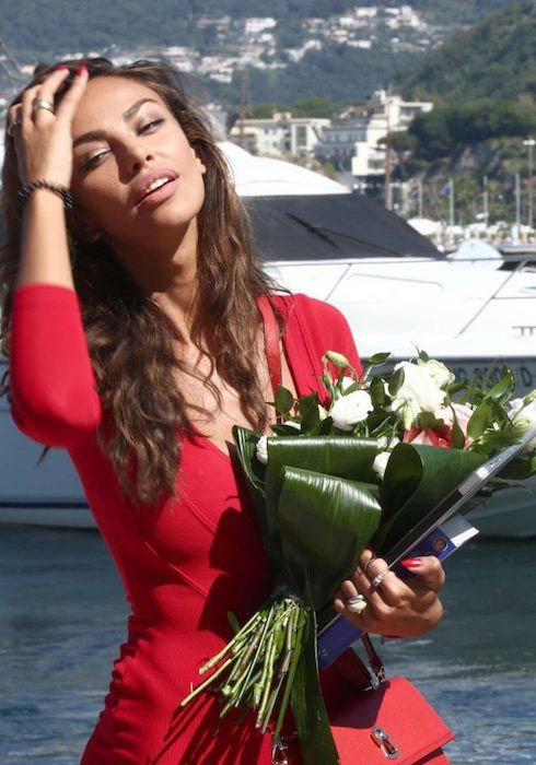 Madalina Ghenea in red dress on July 13, 2016...