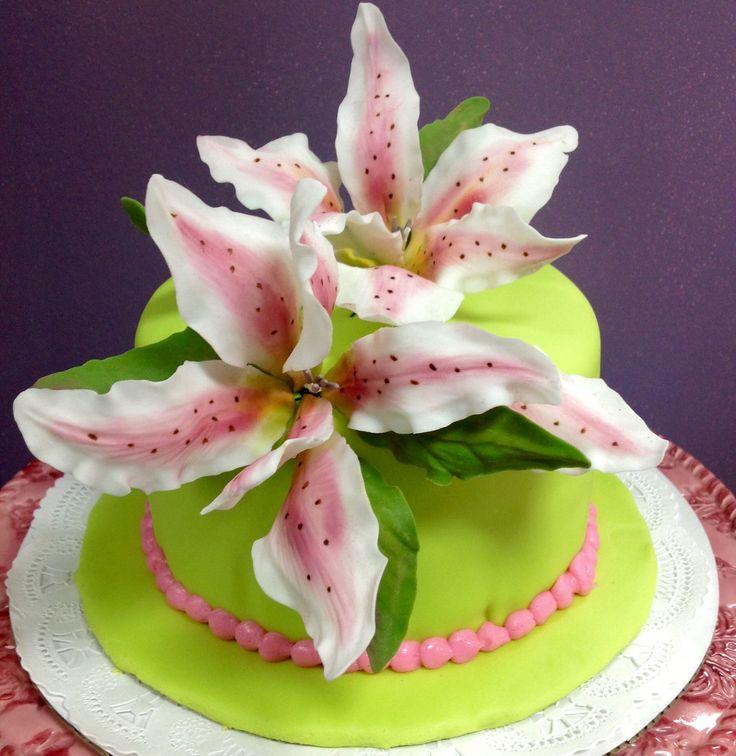 Key lime cake adorned with handmade fondant lilies.