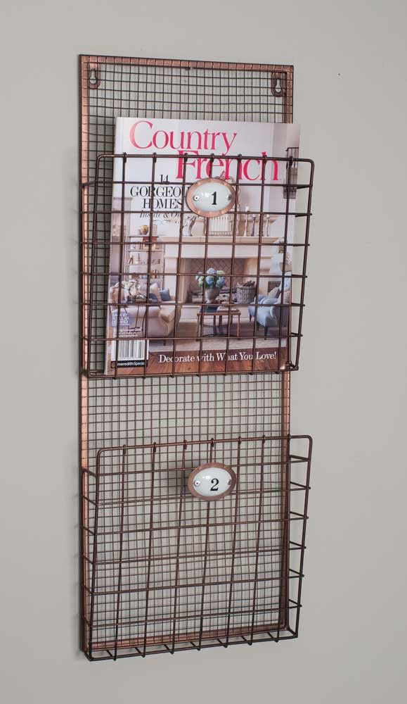 "Metal wire magazine rack with two numbered pockets. This item is trimmed with a copper color, and had two keyholes for easy hanging. Two 9½"" tall pockets are perfect for displaying your favorite magaz"
