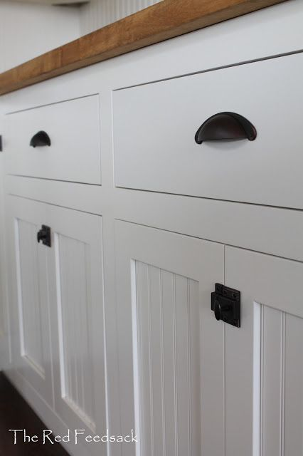 Inset cabinets with old fashioned latches - LURVE!!  Must have someday!!