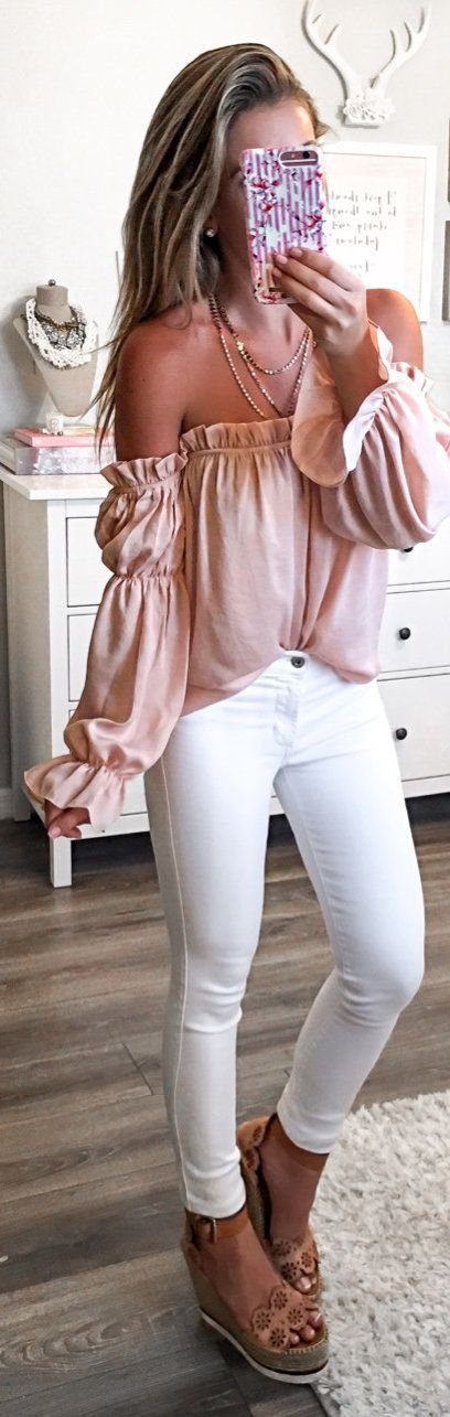 #spring #outfits woman wearing pink off-shoulder top and white fitted jeans and pair of brown leather wedges standing holding Android smartphone. Pic by @laurabeverlin #fitnessoutfits