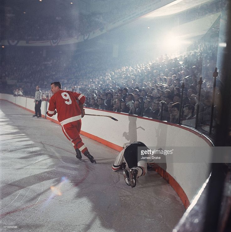 Detroit Red Wings Gordie Howe (9) in action, skating after check vs Chicago Blackhawks Stan Mikita (21) at Olympia Stadium. Game 4. 1966