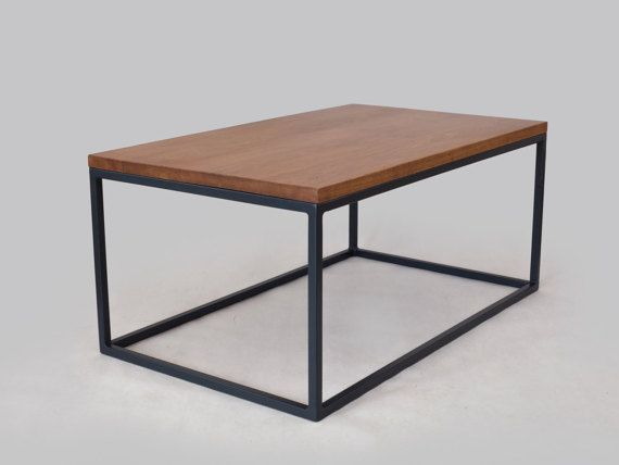 Classic table which enjoys great popularity due to its simple character . The materials used are top in color golden oak and steel base powder coated in graphite . The table gives a unique style to any room in which it is found. Table was made with precision and attention to every detail .  dimensions:  100cm x 60cm x 45 cm  Top is 3 cm thick oak wood.