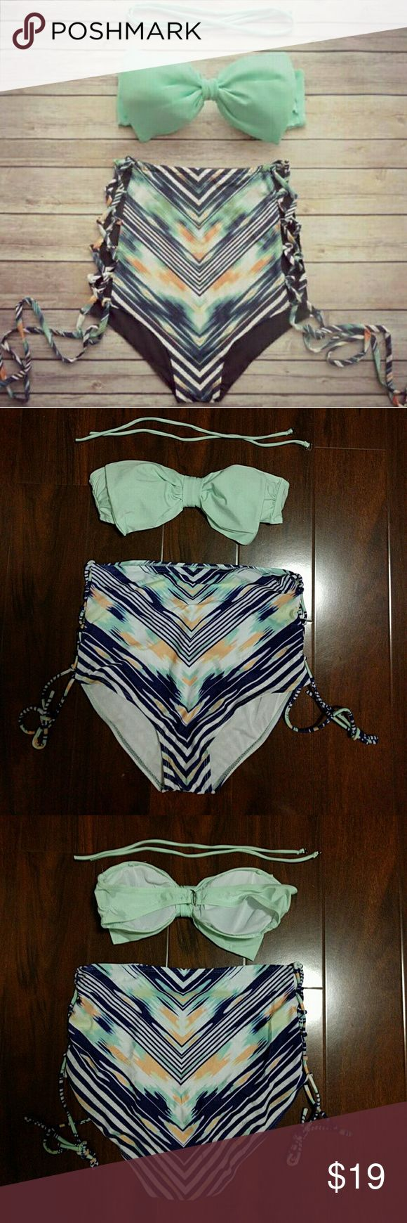 NEW ARRIVAL! GREEN BOW  BANDEAU TOP ONLY NEW ARRIVAL! BRAND NEW GREEN BOW BANDEAU TOP ONLY SELLING ITEMS SEPARATELY. I DO HAVE THE BOTTOMS IF YOU ARE INTERESTED. TOP HAS LIGHT PADDING AND IT HOOKS AT THE BACK. COMES WITH REMOVABLE STRAP THAT GOES AROUND THE NECK. nwot boutique Swim