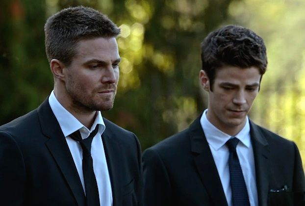 """Brad Pitt yelling, """"What's in the box?!"""" (in Se7en) is nothing compared to Arrow fans' cries of, """"Who's in the grave?!"""" following the Season 4 premiere. """"We don't necessarily know who it is right n..."""