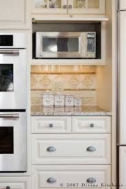 Image result for where to put microwave with hood fan kitchen