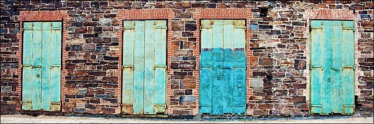 "12 x 36 inch panoramic photograph of four industrial wood blue doors against a colorful brick wall. Image title: 4 door, no wheels While traveling, I have discovered numerous interesting doors. These four doors on an old industrial brick building caught my eye. All photographs are original and photographed by artist Bob Estrin. Print details: - 12"" x 36"" unmatted photograph on paper - Printed at a professional lab on Fuji crystal archive photo paper with lustre finish - Included artist..."