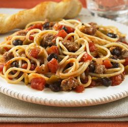 Hot spaghetti tossed with ground beef, spicy tomatoes, onion and black beans for a Tex-Mex twist