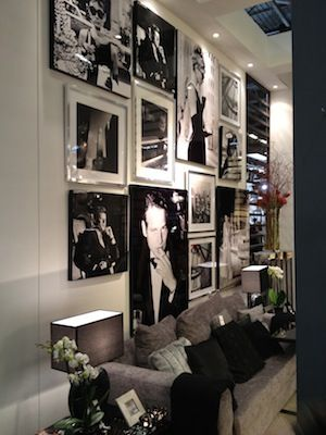 Black and White vintage picture wall, puck lights, showcase art lighting