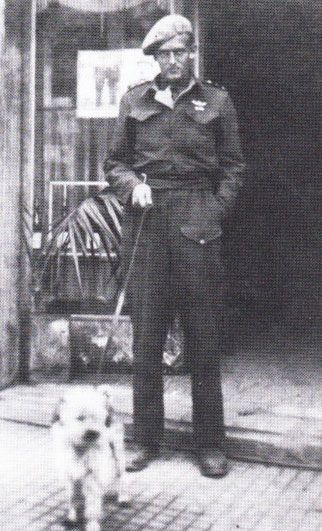 Anders 'Andy' Lassen with his Maltese terrier, Pipo the 'Lion of Leros'. Formerly an Italian officer's lapdog, Lassen had adopted Pipo to be his dog of war. He'd cured Pipo of his addiction to Italian Pasta, and got him eating proper raider food,...pin by Paolo Marzioli