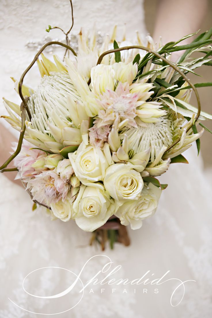 A beautiful spring bouquet made out of white proteas, blushing bride, roses and willow