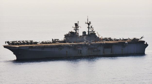 Pentagon moving amphibious warship closer to Libya following attack on prime minister's home,defense official told USNI News May 28, 2014 .USS Bataan (LHD-5) & about 1,000 embarked Marines from 22nd Marine Expeditionary unit currently in E Mediterranean moving closer to country.Transited Suez Canal on Tuesday & could be off Libyan coast early as Thursday.Ship embarked with collection of MV-22 Ospreys,AV-8B Harrier II tactical fighters & AH-1 Cobra helicopter gunships.