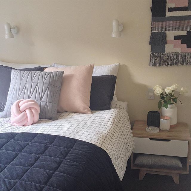 Scandi style bedroom in blush pink, grey, white and black. Grid duvet bedding and Kmart wall hanging and vases