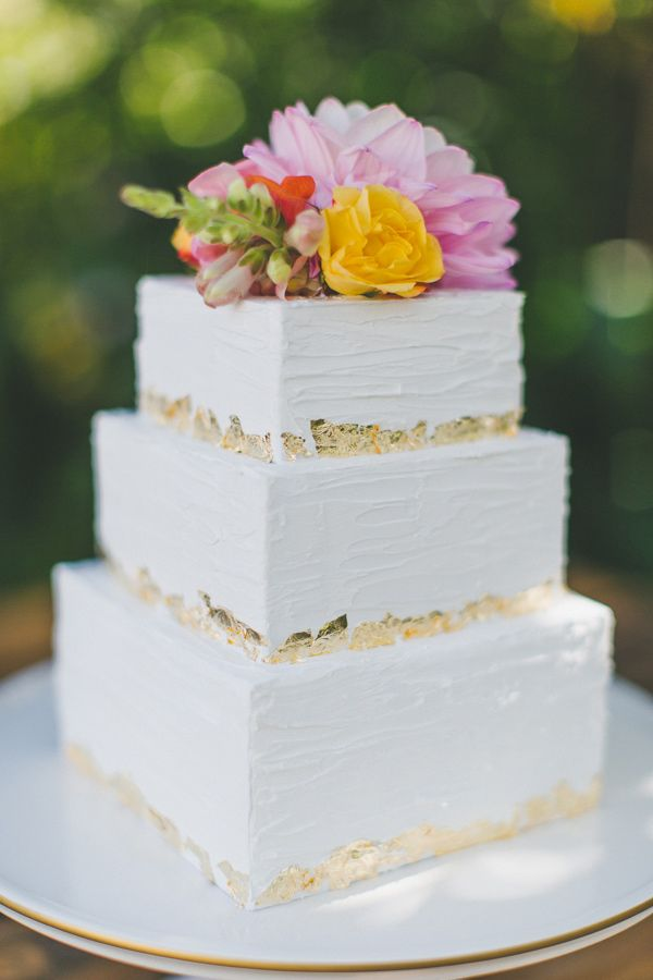 gold flaked cakes - photo by Two Foxes Photography http://ruffledblog.com/tropical-july-4th-styled-wedding