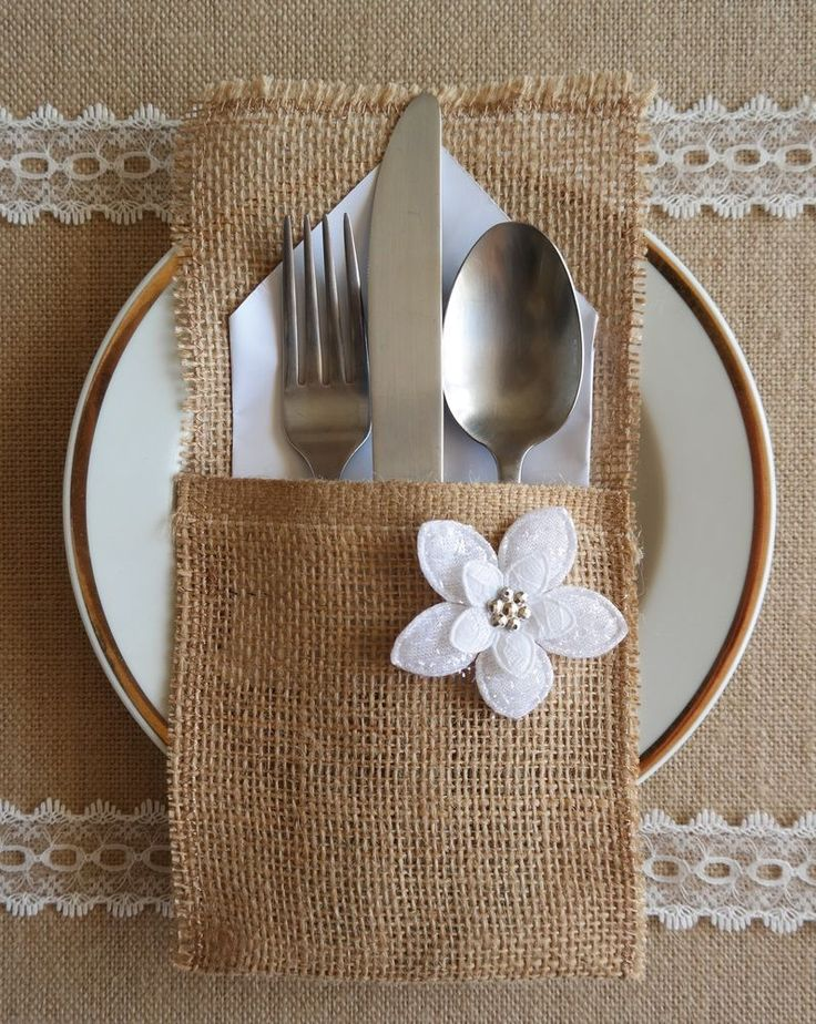 burlap silverware holder with white flower