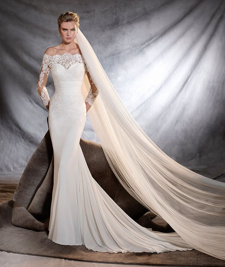 This one is just flat out WOW. It's pretty great all around and hits on the screen star vibe. Minus the big drapey veil.  Overall look I'd like is elegant, sophisticated, sexy and dramatic Dress is Orsa, Pronovias off the shoulder lace wedding dress