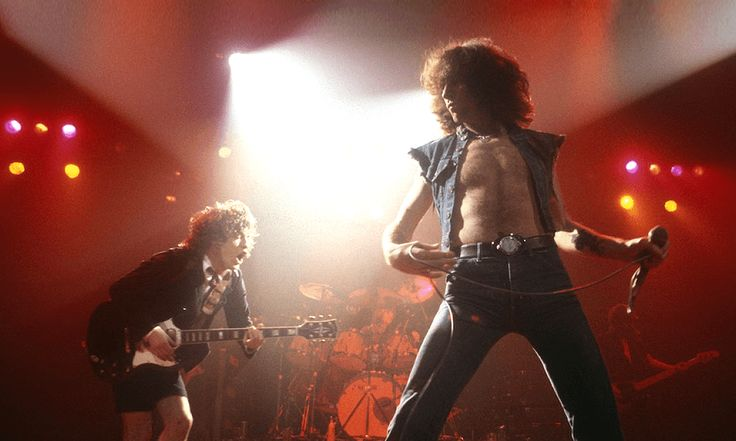 Bon Scott plays with Angus Young . . .  ooh err Missus!
