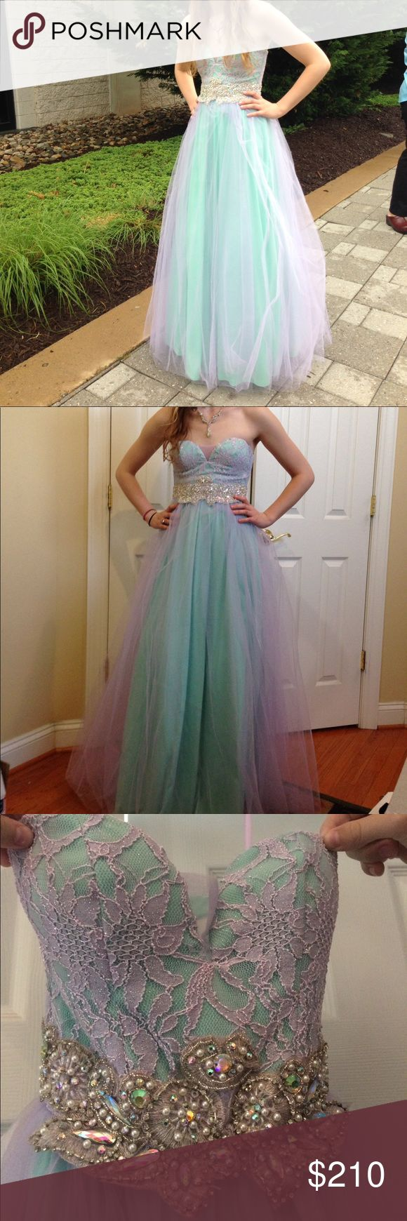 """Nordstrom Prom Quinceanera Dress Full Length Gown Worn once, dry cleaned immediately afterward. Tulle full skirt, has been hemmed. Gorgeous beading. Strapless, but has small hanger straps. Sea foam green base, purple tulle on top. Happy to answer any questions! I am 5""""4 and about 110lbs. and it fit perfectly!!! Pictures are of me actually wearing it at prom and trying it on. Nordstrom Dresses Prom"""