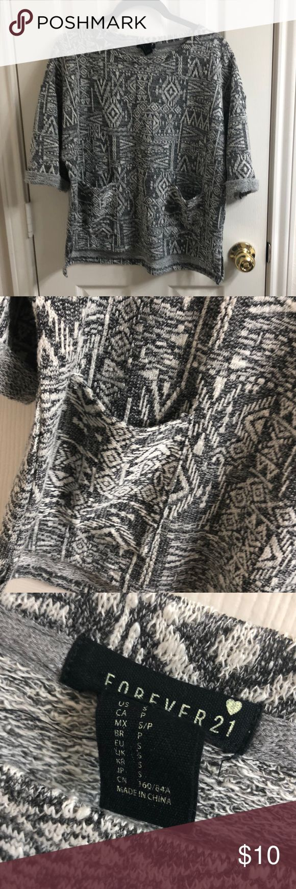 Forever 21 Sweater Shirt Short sleeve grey + white tribal print sweater from Forever 21. Two pockets in front. Never worn! Forever 21 Sweaters Crew & Scoop Necks